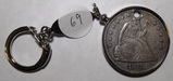 1871 LIBERY SEATED DOLLR IN BEZEL (HOLED)