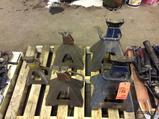 Lot of jack stands and lot of grease/lubrication guns