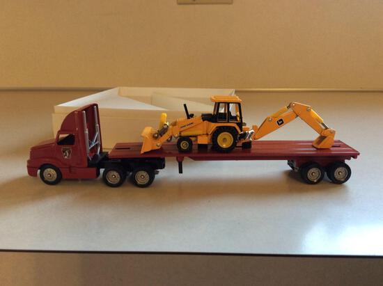 Manor Township Winross flat bed truck with John Deere backhoe in box