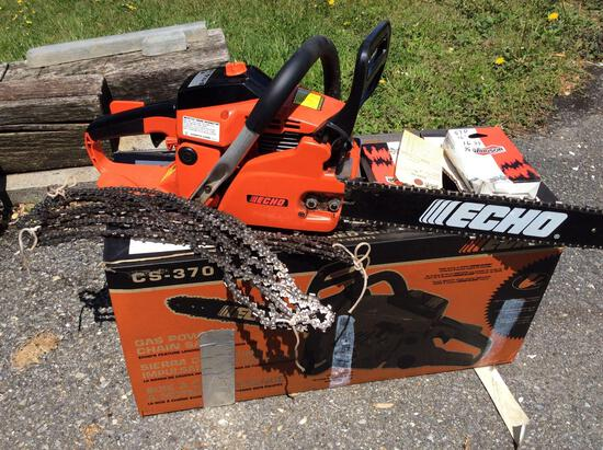 Echo CS 370 chain saw like new with extra chains