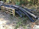 QTY OF MISC BLACK CORRUGATED PIPE W/ METAL RACK