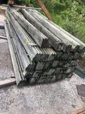 Stack of interlocking treated timbers