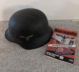 Helmet with German Swastika and booklet