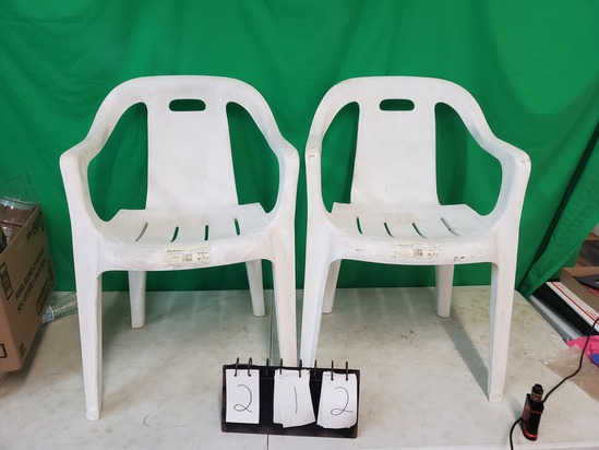 2 white patio chairs