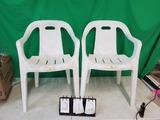 2 white patio chairs