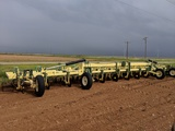 12 ROW ROLLACONE CLEAN OUT RIG W/ COULTERS & ROLLING BASKETS