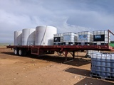 SEMI FLAT BED TRAILER RIGGED W/ FERTILIZER TANKS