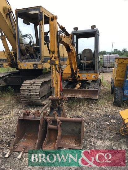 JCB 803 rubber tracked excavator with buckets