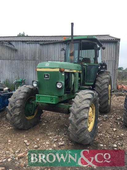 John Deere 4240 4wd tractor with SG2 cab. Replacement window glass in office.