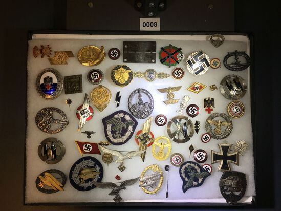 Collection of Nazi pins and badges. All items in lot photos are included.