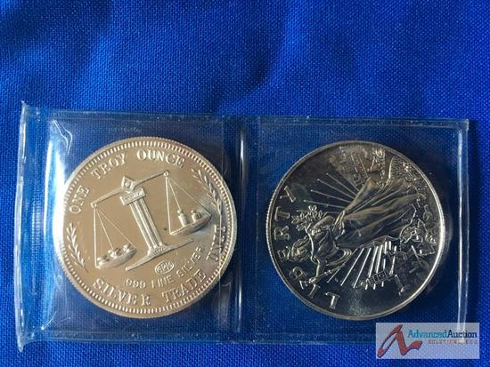 Two, 1 Troy ounce silver trade units