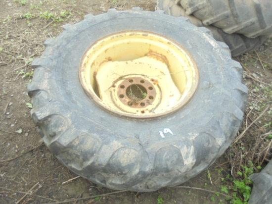 16.9 - 24 Tire & 8 bolt Ford rim (tire sliced)