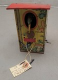 Early Tin Mechanical Coin Bank with Key