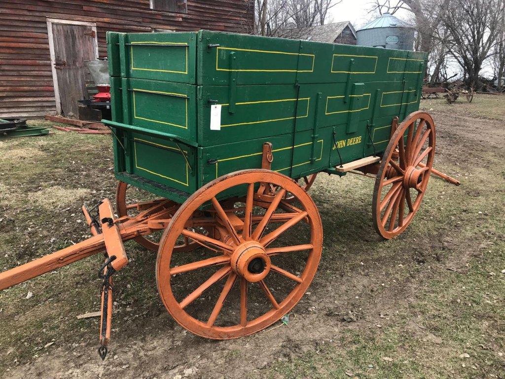 "John Deere horse drawn wooden wagon. 3' x 10.5'. Wood spoke wheels (rears are 54"", front are 44"") In"