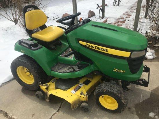 JD X534 4- wheel steer riding lawn mower,54 inch power lift deck, 343 hours, Kawasaki gas engine,