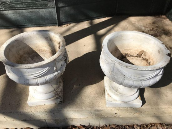 """2 - 14""""W x 17""""H concrete flower pots. One has a chipped corner. No Shipping."""