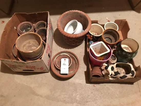 Various clay and plastic flower pots