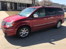 2008 Town and Country Chrysler van, red exterior