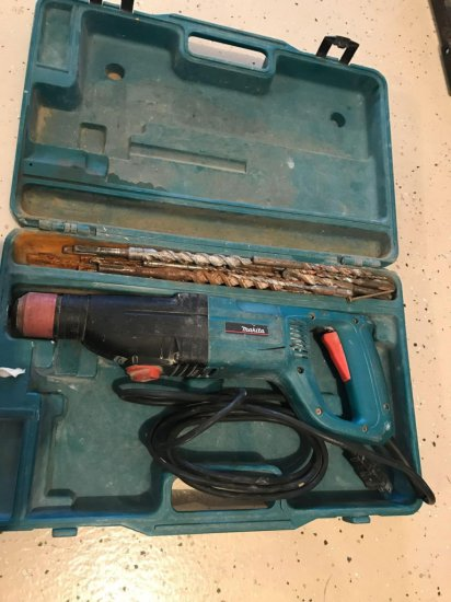 Makita model HR2420 electric cement hammer drill with case