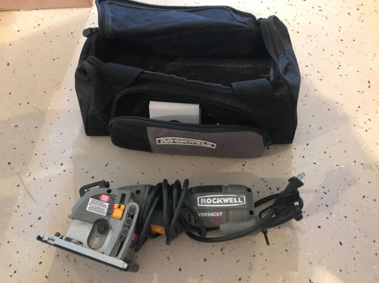 Electric Rockwell Versacut 3-3/8'' saw with laser guide and storage bag. Like new.