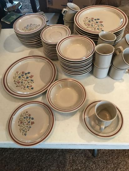 12 Place setting of Newcor stoneware, (12) dinner plates, (11) bowls, (12) pie plates, (12) saucers,