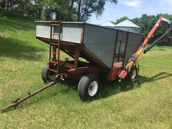 "Heider 250 bushel seed tender gravity box w/ 6"" auger and Briggs and Stratton 6 h.p. motor on"