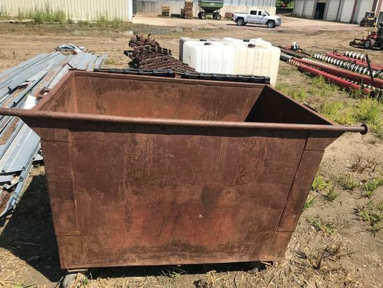 42'' x 64'' steel dumpster, average condition on flooring.
