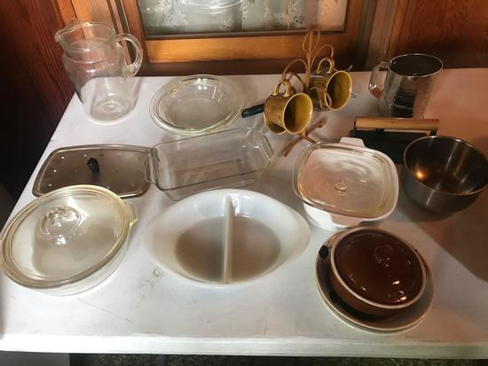 Misc. dishes, water pitcher, casserole dishes, flour sifter, and more.