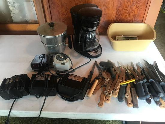Coffee pot, several knives and butcher knives, 3 Freshen Aire units, timers, and more!