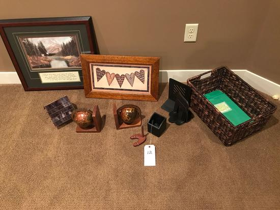 Matted and framed eagle/mountain scenery, a lidded glass bird house, book ends, and weaved basked.