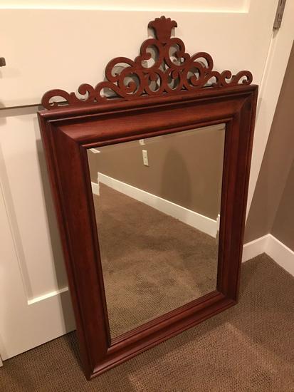 Cherry wood framed beveled edge mirror - 25'' wide x 33'' tall, w/ decorative top.