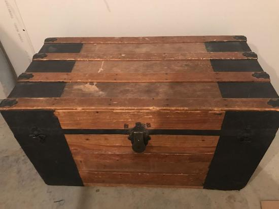 Antique slat back style trunk with rope handles. Nice condition