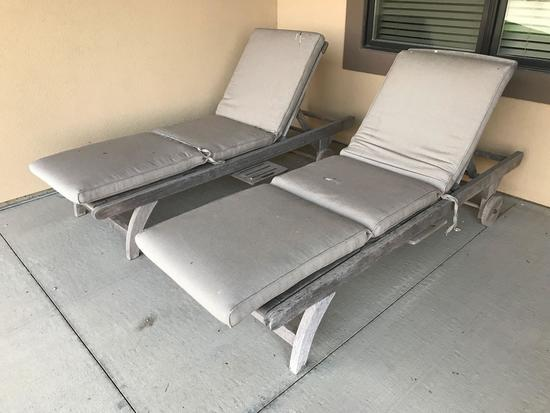2 wood patio Lounge Chairs w/ pads both chairs have a pull out beverage tray