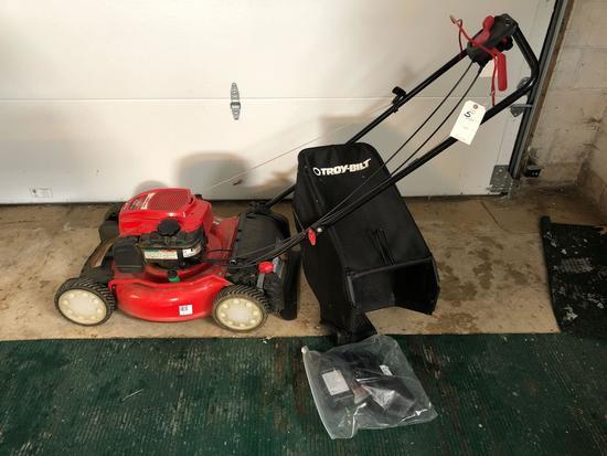 Troy-bilt real wheel drive, 21'' cut, 163cc, B&S motor, self propelled and includes bagger, like