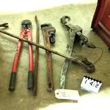 Assortment inc. Cable Come a Long, Pipe Wrench, and Bolt Cutters