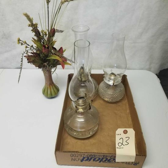 Assortment inc. Kerosene Lamps and Flower Display