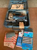 Bosch saber saw with tilt bed, including case and extra blades. Shipping
