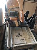 Felker FTS-150 wet tile saw and stand plus 2 blades. Very nice! No shipping