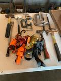 Various C clamps, prybar, ratchet straps, hammers, rubber mallet, small sledge hammer