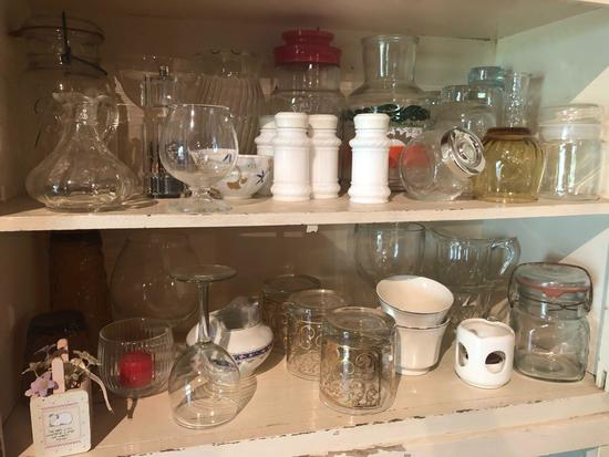 Misc. glasses, lidded fruit jars, stem glasses, water pitcher and more.