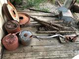 Various older gas cans, (2) steel rims, horse double-trees, well pipe-clamp, and barn wind-vane