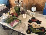 Misc. dishes, glass pie plates, decorative wall ornaments (car collection), flower vases, relish