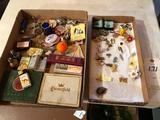 Various tie tacks, Lone Ranger badge, Camel cigarette lighters, Lucky Strike cigarette tins,