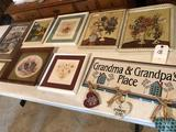 Various framed prints and barn-wood framed