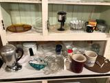 Clarion, IA crock, small mixing bowl, glass juicers, refrigerator dishes, coffee pots, tins, and