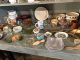 Enamel pie pans, coffee cups, crocks, and smaller dishes.