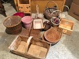 Plastic tote full of wicker baskets & wood boxes.