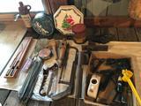 Vintage tins, old manual-pump fly sprayer, wood plane, steel doorknobs and more.
