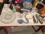 Punch bowl set, lidded bean pot, porcelain lighted house, and other dishware.