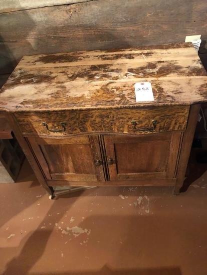 Commode dresser w/tiger oak drawer-front (33'' W x 18'' D x 28.5'' H), needs repair on top. No